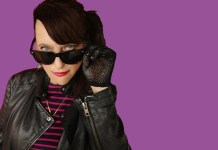 woman with sunglasses wearing leather jacket