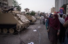 Egyptian Police Fire Tear Gas At Pro-Mursi Protest Camp In Cairo