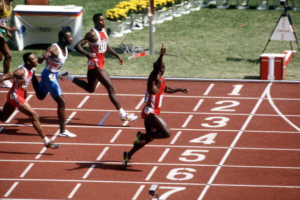 1988 Olympic Games, Seoul, South Korea, Men's 100 Metre Final, Canada's Ben Johnson crosses the line to win the gold medal followed by USA's Carl Lewis for silver and Great Britain's Linford Christie for bronze, Johnson was later stripped of his gold meda