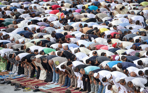 The prayer of the local Muslim community during the Eid al-Adha in Turin, Italy at Parco Dora (Dora Park).