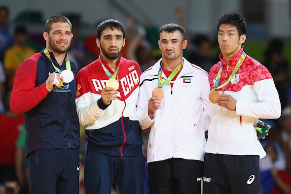 (L-R) Silver medalist Travis Stevens of the United States, gold medalist Khasan Khalmurzaev of Russia and bronze medalists Sergiu Toma of United Arab Emirates and Takanori Nagase of Japan