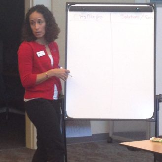 Oil spill science specialist Monica Wilson awaits breakout group input.