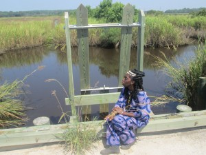 Queen Quet, Chieftess of the Gullah/Geechee Nation (www.QueenQuet.com) sits where Gullah/Geechee ancestral spirits gather at a Carolina Gold rice trunk on Jehosee Island and pays tribute to their knowledge, labor, and souls.