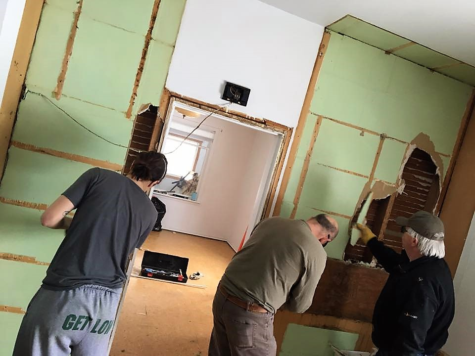Volunteers Help With Funeral Home Renovations