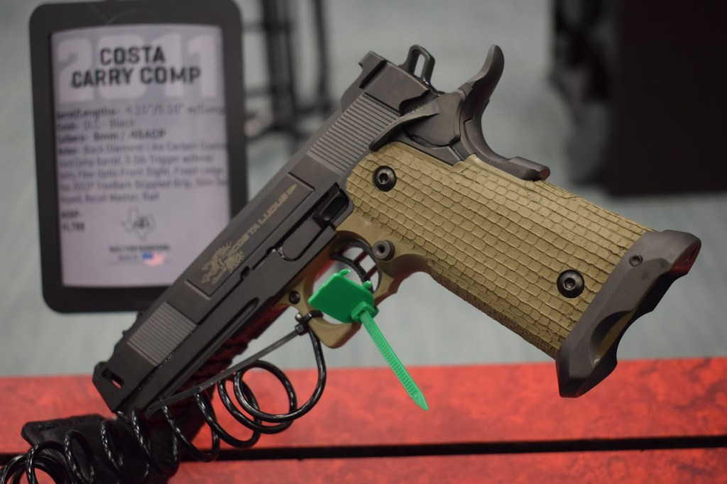 STI International race gun with green stippled grips and DLC coating finish
