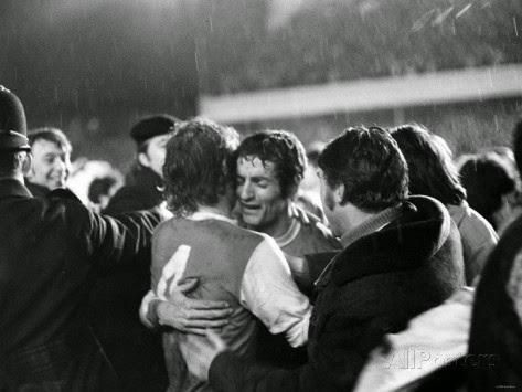 Frank McLintock and Eddie Kelly embrace after winning the Fairs Cup in 1970