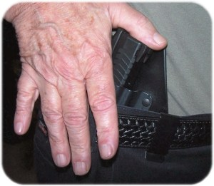 The Final Push - Note Thumb on Top of  Rear of Slide as Fingers Continue to Protect the Firearm