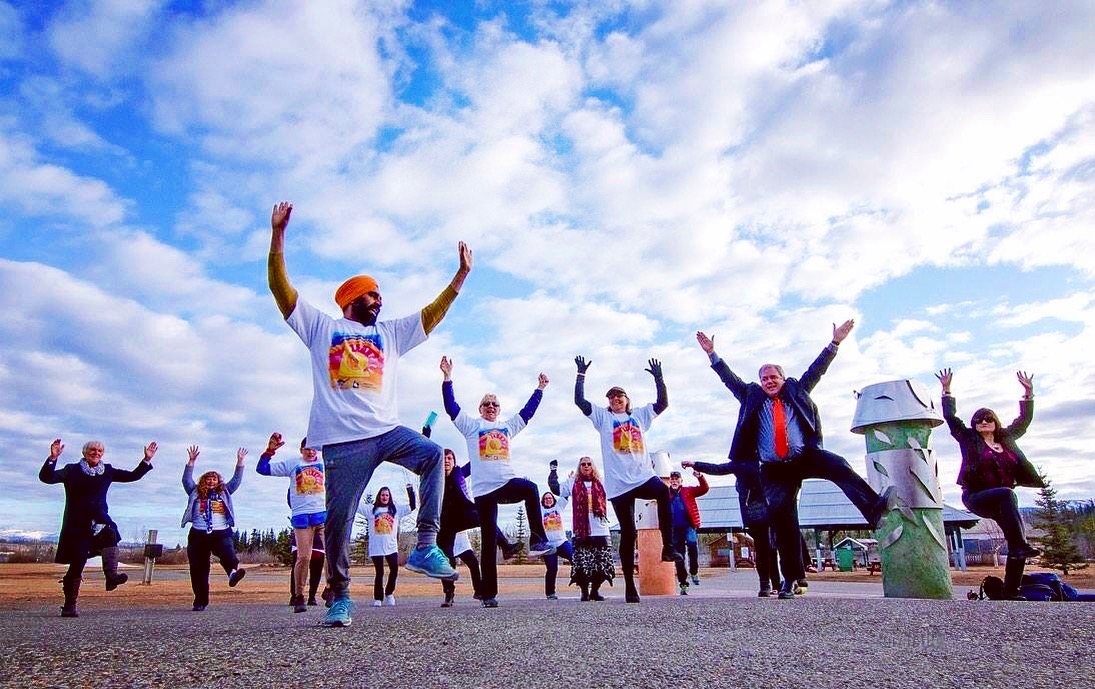 The Mental Health Association of Yukon's annual Positive Steps to Mental Health Walk took place Tuesday at Shipyards Park. Gurdeep Pandher, front, warmed up the group with Bhangra dance | Whitehorse Star photo by: VINCE FEDOROFF