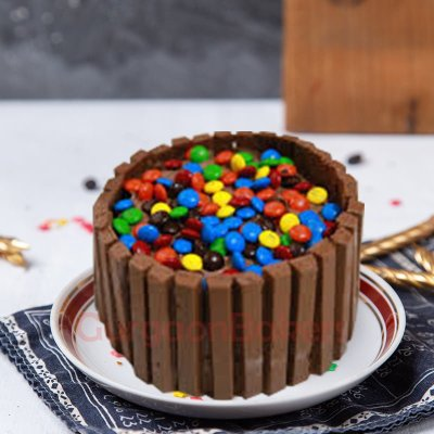 half kg kitkat and gems cake