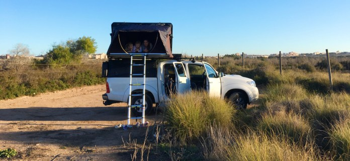 Family in rooftop tent on Toyota Hilux