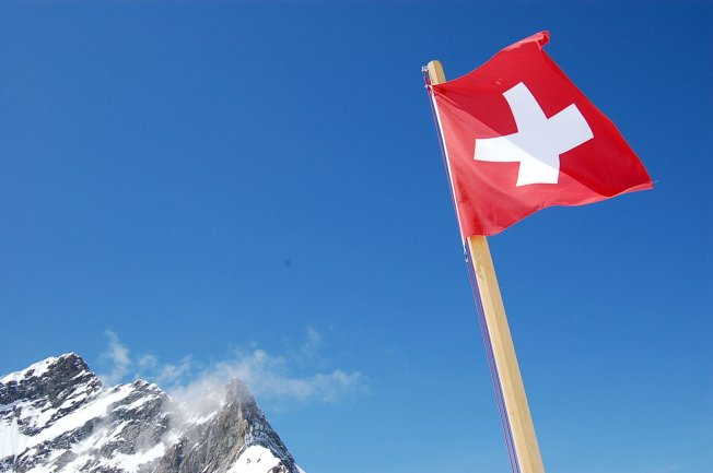 Swiss Flag and Alpine Peak, Flickr, CC, by Curious Expeditions