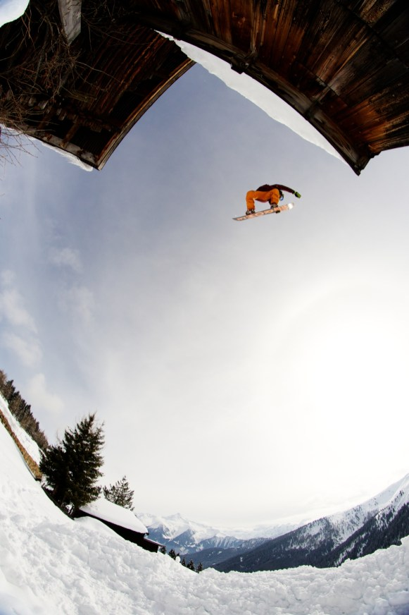 Thomas Delfino sending a method air off of a roof. Mayrhofen, Austria.
