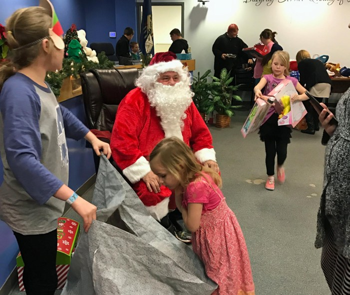 Combined effort helps 33 children with Christmas gifts