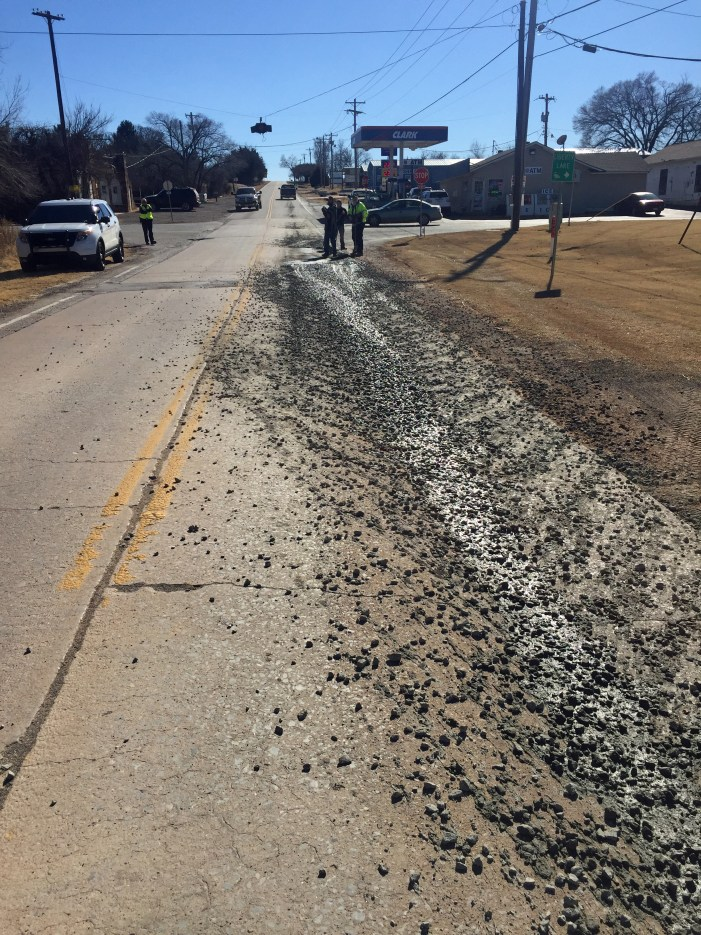 Oops! Cement spills onto Sooner Road; part of roadway was blocked