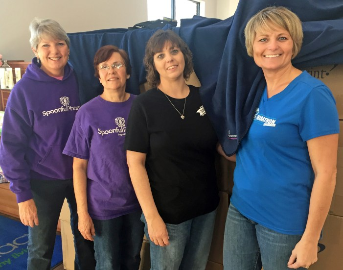 Spoonful Pharmacy donates blankets to the aging