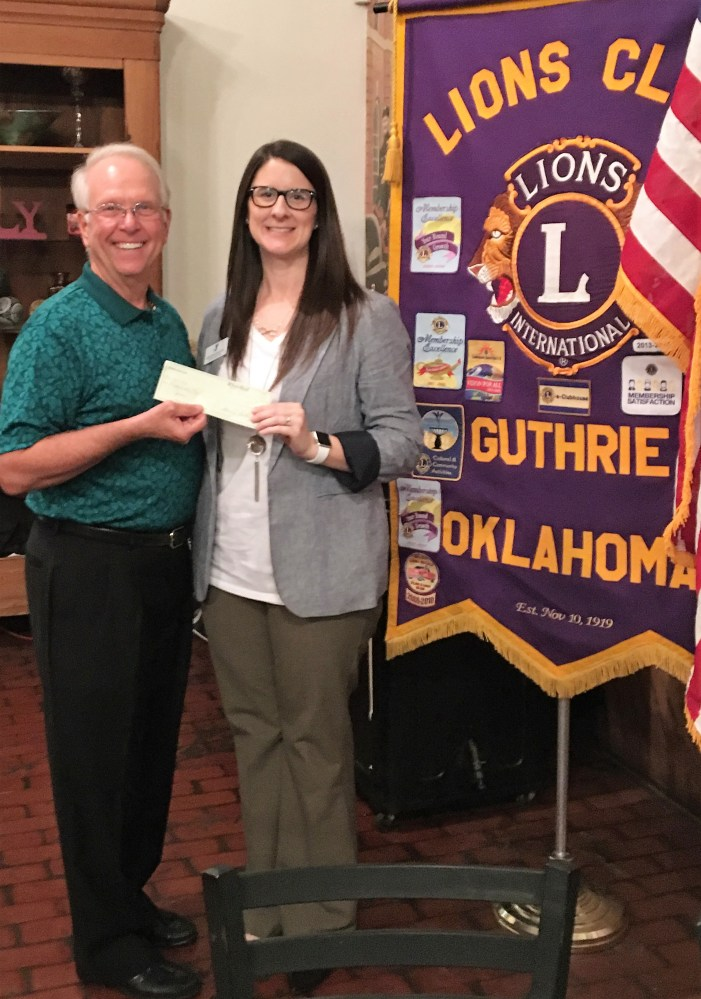 Lions Club contribute $500 to the YMCA