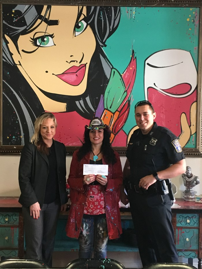 Tipsy Artist makes donation for Christmas with Cops program