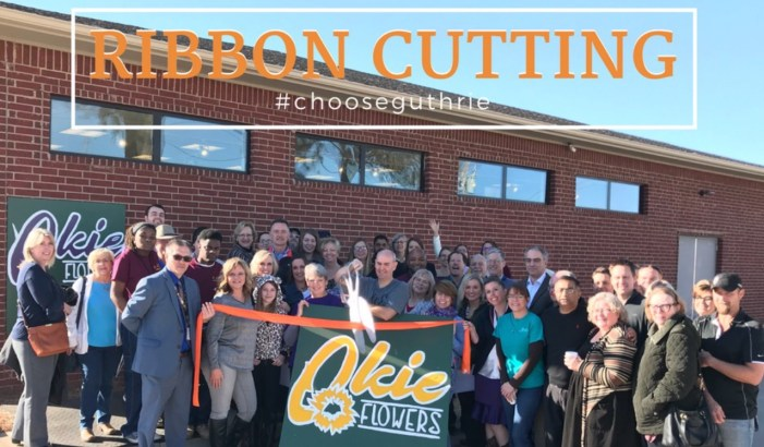 Okie Flowers cuts the Chamber ribbon