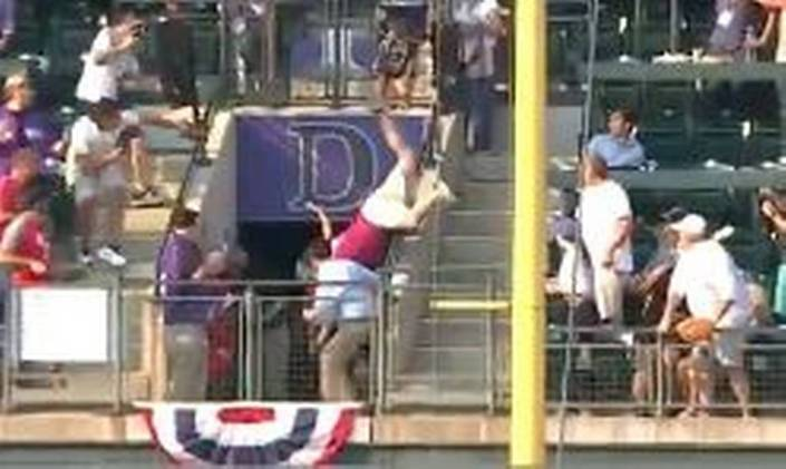 Fan takes a big fall chasing home run ball…