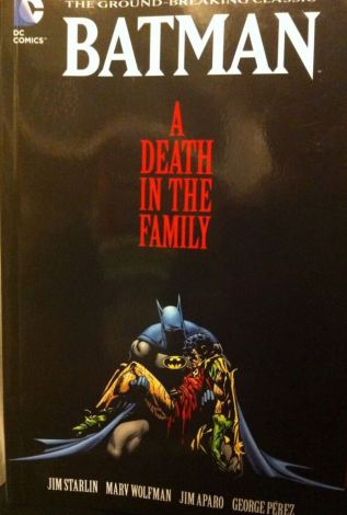 Batman: A Death In The Family, written by Jim Starlin, pencils by Jim Aparo, inks by Mike Decarlo, and colours by Adrienne Roy, with letters by John Costanza.