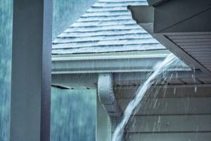 Rain water overflows gutter