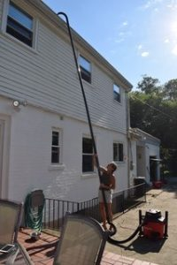 Second story gutter cleaning done safely using Gutter Clutter Buster