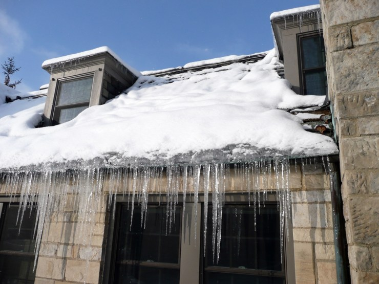 prevent winter damage to your gutters ice dam
