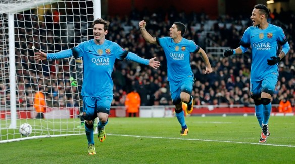 Barcelona players Neymar, right, and Luis Suarez celebrate after Lionel Messi, left, scored the second goal during the soccer Champions League round of 16 first leg soccer match between Arsenal and Barcelona at the Emirates stadium in London, Tuesday, Feb. 23, 2016. (AP Photo/Frank Augstein)