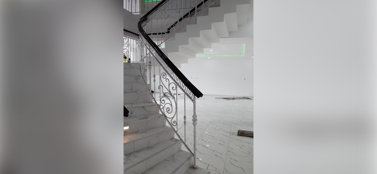 staircase with white painted wall