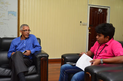 Minister of Business, Dominic Gaskin during an interview with Chronicle's Navendra Seoraj yesterday in his Office.