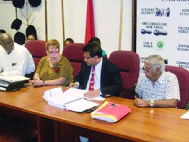 President of Western Scientific Company Edwin Mackoon (second from right) signing a contract in Guyana (GINA photo)