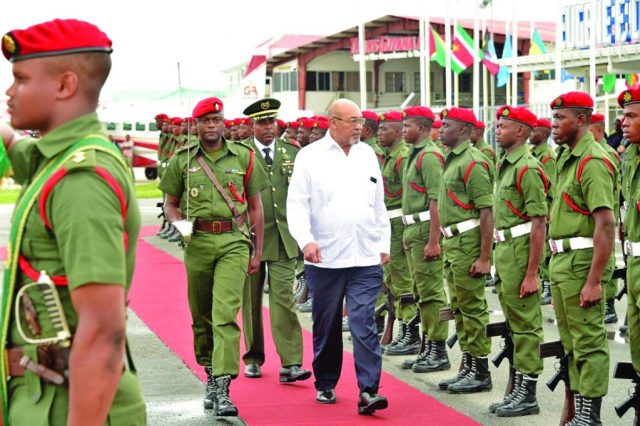 President Désiré Delano Bouterse of Suriname inspecting the Guard of Honour mounted by ranks of the Guyana Defence Force