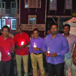 PPP Executive Members at the peaceful candlelight vigil on Friday night to voice its concerns over Government's move to evict the Cheddi Jagan Research Centre from Red House