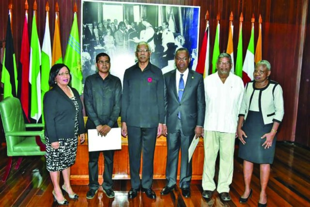 Members of the new Public Procurement Commission posed with President David Granger in October shortly after their appointment