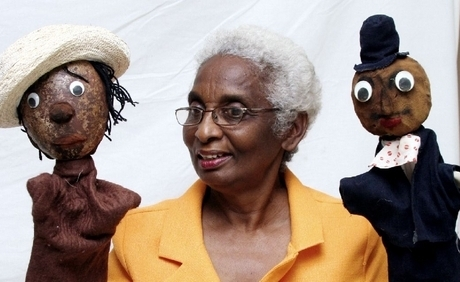 Jean Small manipulates two puppets during a Portmore puppet show at the Lions' Civic Centre during Portmore Week activities in 2008. - photo by Anthony