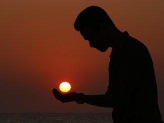 outdoors man holding sun