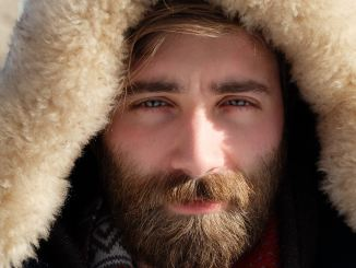 guy with beard looking in the screen