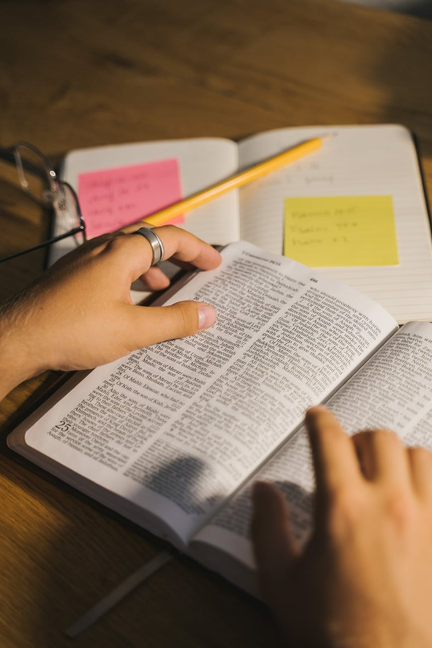 close up shot of a person reading a bible