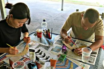 Yran and Korean student Noori at the Boomerang Painting activity