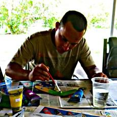 Yran painting his Boomerang