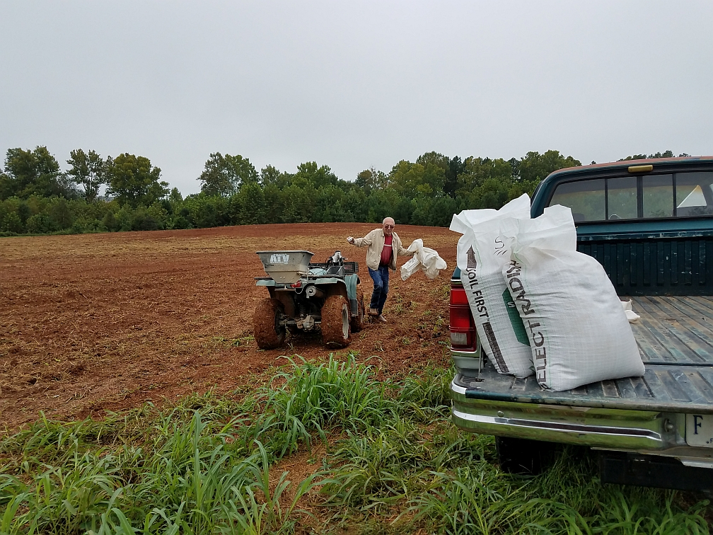 Lawrence Bennett plants radish and barley cover crop demonstration at The Carver Center in September.  Battle Park Farms prepared the land, CFC Farm and Home and County Farm Service both donated seed.