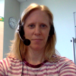 Gwen wearing a headset and red-and-white striped shirt