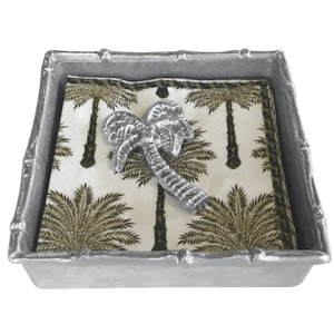 A vibrant palm tree decorates the cocktail napkins paired with a handcrafted Palm Tree Napkin Weight and Bamboo Napkin Box.