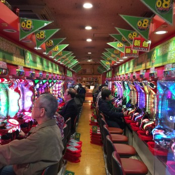 Pachinko parlors, a popular arcade game, are filled with smoke and mostly men, old and young.
