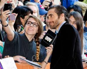 "Jake Gyllenhaal poses for pictures with fans as he arrives for the ""Enemy"" screening at the 38th Toronto International Film Festival in Toronto"