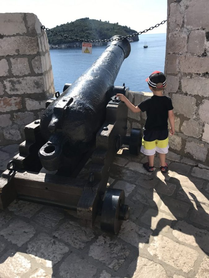 boy next to a cannon