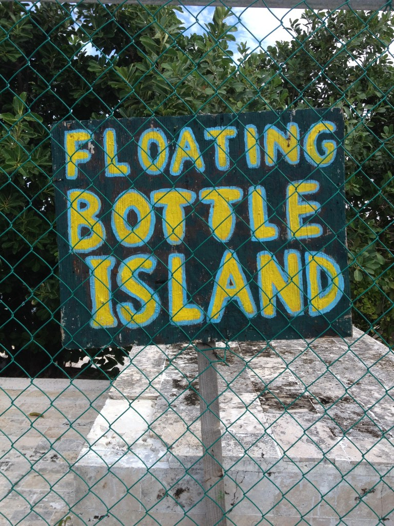 a sign saying floating bottle island