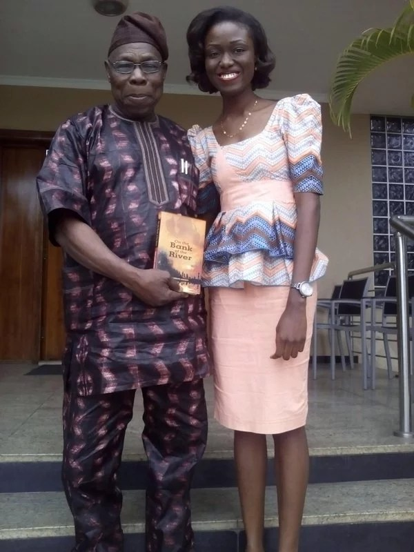 Former President Olusegun Obasanjo with Ife Adeniyi's Novel Book '' On the Bank of the River ''