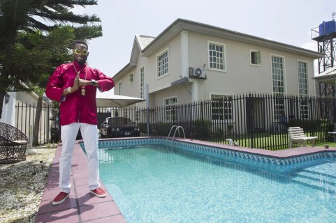D'banj by the pool side of lekki home in Lagos (Photographer: Paul )Odijie/Bloomberg