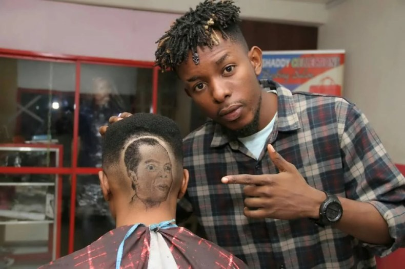 Barber Creates Fela Face On Client Head 00